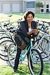 Woman Texting on Bicycle at School Stock Photo - Premium Rights-Managed, Artist: Kevin Dodge, Code: 700-03762629