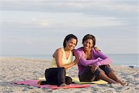 Two Women Sitting on Yoga Mats on Beach Stock Photo - Premium Rights-Managednull, Code: 700-03762643