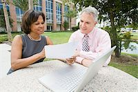 Business People with Laptop Outdoors Stock Photo - Premium Rights-Managednull, Code: 700-03762664