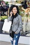 Woman Shopping and Using Cell Phone Stock Photo - Premium Rights-Managed, Artist: Kevin Dodge, Code: 700-03762684
