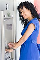 Woman Using ATM Stock Photo - Premium Rights-Managednull, Code: 700-03762695