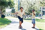 Mother and Son Skateboarding in Park Stock Photo - Premium Rights-Managed, Artist: Kevin Dodge, Code: 700-03762718