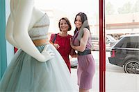 Mother and daughter looking at wedding dress in shop window Stock Photo - Premium Royalty-Freenull, Code: 614-03763841
