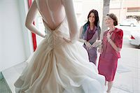 Mother and daughter looking at wedding dress in shop window Stock Photo - Premium Royalty-Freenull, Code: 614-03763890