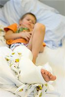 Boy Wearing Cast on Leg Stock Photo - Premium Rights-Managednull, Code: 700-03768690