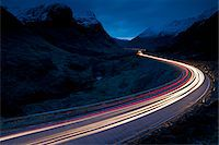 streaming - Trails of Car Lights at Dusk through Mountainous Valley, Glen Coe, Scotland Stock Photo - Premium Rights-Managednull, Code: 700-03768719