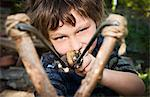 Boy aiming catapult Stock Photo - Premium Royalty-Free, Artist: Uwe Umstätter, Code: 649-03769460