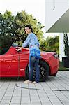 Women filling up her electric car Stock Photo - Premium Royalty-Free, Artist: Transtock, Code: 649-03769985