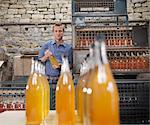 Man with bottles of organic cider Stock Photo - Premium Royalty-Free, Artist: Ikon Images, Code: 649-03770276