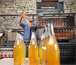 Man with bottle of organic cider Stock Photo - Premium Royalty-Free, Artist: Ikon Images, Code: 649-03770277