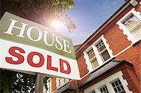 sold sign - House with SOLD notice Stock Photo - Premium Royalty-Freenull, Code: 649-03770416