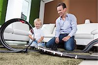 remote car - Father and son playing with race track Stock Photo - Premium Royalty-Freenull, Code: 649-03770647