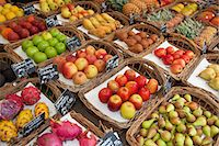 Various fruits presented on a market Stock Photo - Premium Royalty-Freenull, Code: 649-03771919