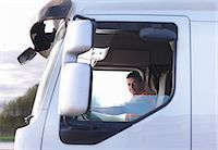 side view tractor trailer truck - Truck driver in cab Stock Photo - Premium Royalty-Freenull, Code: 649-03773434
