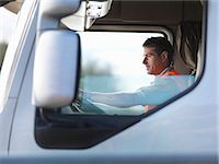 side view tractor trailer truck - Truck driver in truck cab Stock Photo - Premium Royalty-Freenull, Code: 649-03773435