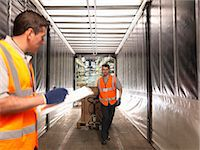 side view tractor trailer truck - Workers loading truck Stock Photo - Premium Royalty-Freenull, Code: 649-03773448