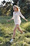 Women in white dress running in nature