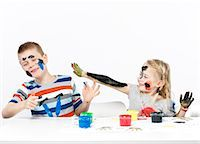 finger painting - Kids playing with finger paint Stock Photo - Premium Royalty-Freenull, Code: 649-03774390