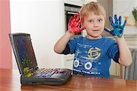 finger painting - Boy showing dirty hands Stock Photo - Premium Royalty-Freenull, Code: 649-03774403