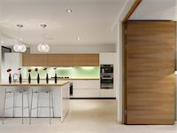 Open plan kitchen with breakfast bar, private House, Worsley. Architects: Stephenson Bell Stock Photo - Premium Rights-Managednull, Code: 845-03777451