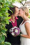 Newlywed Couple Kissing Stock Photo - Premium Rights-Managed, Artist: Bettina Salomon, Code: 700-03777761