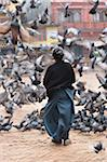 Woman Feeding Pigeons, Boudhanath, Bagmati, Kathmandu, Nepal Stock Photo - Premium Rights-Managed, Artist: Jochen Schlenker, Code: 700-03778222