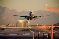 Airplane Taking Off at Sunset Stock Photo - Premium Rights-Managednull, Code: 700-03778516