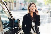 Woman Near Car Talking on Cell Phone Stock Photo - Premium Rights-Managednull, Code: 700-03778621
