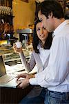 Couple using laptop computer in cafe Stock Photo - Premium Royalty-Free, Artist: Cusp and Flirt, Code: 632-03779647