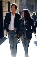 Couple walking together, backlit Stock Photo - Premium Royalty-Freenull, Code: 632-03779691
