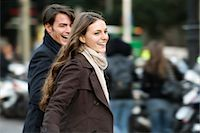 Young couple laughing and walking together outdoors Stock Photo - Premium Royalty-Freenull, Code: 632-03779699