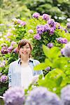 Happy Smiling Woman Standing In Garden Stock Photo - Premium Rights-Managed, Artist: Aflo Relax, Code: 859-03779843