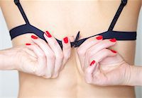 Close up of Woman's Hands with Red Nail Polish Fastening Bra - Back view Stock Photo - Premium Rights-Managednull, Code: 822-03780921