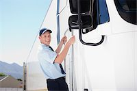 side view tractor trailer truck - Truck driver standing on side of semi-truck Stock Photo - Premium Royalty-Freenull, Code: 635-03781323