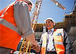 Construction workers shaking hands on construction site Stock Photo - Premium Royalty-Freenull, Code: 635-03781440