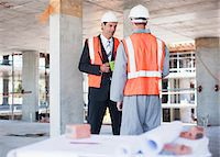 supervising - Businessman talking to construction worker on construction site Stock Photo - Premium Royalty-Freenull, Code: 635-03781504