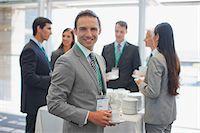 Business people having coffee break in office Stock Photo - Premium Royalty-Freenull, Code: 635-03781803