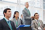Business people attending seminar in office Stock Photo - Premium Royalty-Free, Artist: Blend Images, Code: 635-03781861