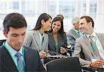 Business people talking in seminar in office Stock Photo - Premium Royalty-Free, Artist: Transtock, Code: 635-03781869