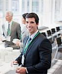 Businessman drinking coffee in office Stock Photo - Premium Royalty-Free, Artist: Robert Harding Images    , Code: 635-03781873