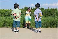 Boys Holding Flowers for Girl Stock Photo - Premium Rights-Managednull, Code: 859-03782443