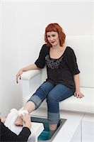 foot massage - Foot masseuse and client in beauty salon Stock Photo - Premium Royalty-Freenull, Code: 693-03782619