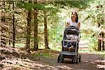 Woman Walking in Forest with Stroller Stock Photo - Premium Rights-Managed, Artist: Jim Craigmyle, Code: 700-03787164