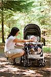 Woman Feeding Baby Girl in Forest Stock Photo - Premium Rights-Managed, Artist: Jim Craigmyle, Code: 700-03787170