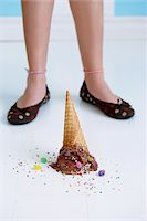 Dropped Chocolate Ice Cream Cone Upside Down on Floor at Girl's Feet Stock Photo - Premium Rights-Managednull, Code: 700-03787304