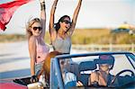 Girls having fun riding a cabriolet