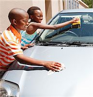 Young boy and girl cleaning car, Johannesburg, South Africa Stock Photo - Premium Royalty-Freenull, Code: 682-03797951