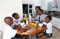 Family sitting at breakfast table, Johannesburg, South Africa Stock Photo - Premium Royalty-Freenull, Code: 682-03797973