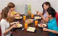 Children Eating Pasta Stock Photo - Premium Royalty-Freenull, Code: 600-03799491
