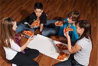 Children Eating Pizza Stock Photo - Premium Royalty-Freenull, Code: 600-03799499